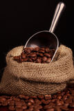 Coffee beans spilling Royalty Free Stock Photography