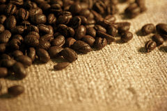 Coffee Beans spilling from a burlap Stock Photography
