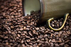 Coffee Beans spilling from a cup. Coffee beans spilling from a coffee cup Stock Photo