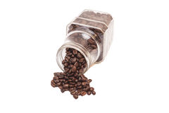 Coffee beans spilling out of a cristal jar Stock Photography