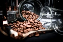 Coffee Beans Spoiling on Clear Glass Jar Near Clear Glass Mug Stock Images