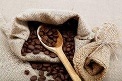 Coffee beans in a spoon. Coffee beans in a spoon on sacking Royalty Free Stock Photos