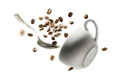 Coffee beans spoon and Cup in flight.  royalty free stock image