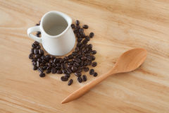 Coffee Beans. With a spoon and a little jar Stock Photos