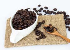 Coffee beans on spoon Royalty Free Stock Image