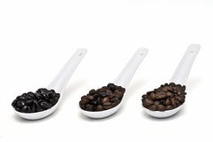 Coffee beans in spoons. Royalty Free Stock Photo