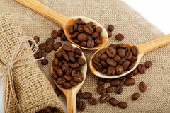 Coffee beans in a spoons. Coffee beans in a spoons on sacking Stock Photography