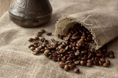 Coffee beans spread from linen pocket. Selective focus Stock Image