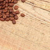 Coffee beans spread over table - close up shot Stock Photos