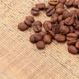 Coffee beans spread over wooden table - close up shot Stock Photography