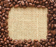 Coffee beans square frame on sacking Royalty Free Stock Photo