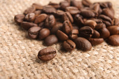 Coffee beans on stack Royalty Free Stock Image