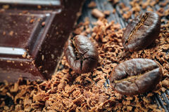 Coffee beans and stack of brown chocolate Royalty Free Stock Photo