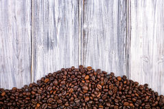 Coffee beans stacked  on the old wooden background Stock Photography