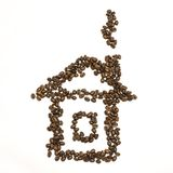 Coffee beans are stacked in the shape of house Stock Images