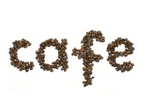 Coffee beans stacked to form the word cafe Stock Images