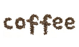 Coffee beans stacked to form the word coffee Royalty Free Stock Photos