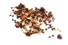 Coffee beans, star anice, cinnamon on a white bacground. Isolat. Пreen and fried сoffee beans, star anice, cinnamon on a white bacground. Isolat royalty free stock images