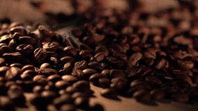 Coffee beans with star anise on barrel, cam moves to the right, close up stock footage