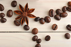 Coffee beans and star anise closeup on wooden background Royalty Free Stock Photography