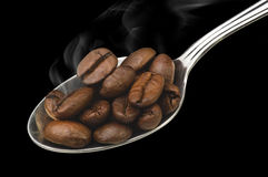 Coffee beans steaming Stock Images
