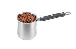 Coffee beans in steel cezve Stock Image
