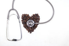 Coffee beans with a stethoscope Royalty Free Stock Image