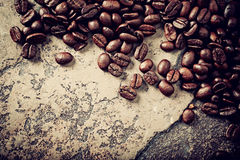 Coffee beans on a stone background Royalty Free Stock Image