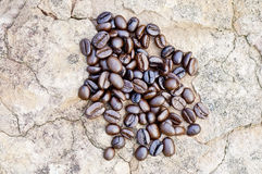 Coffee beans. On a stone surface Royalty Free Stock Image