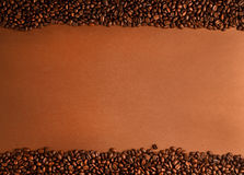 Coffee beans stripes. On brown background Royalty Free Stock Photo