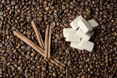 Coffee beans, sugar and cinnamon Stock Photo