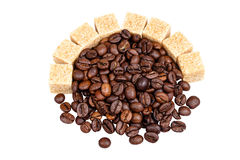 Coffee beans and sugar. Coffee grains and refined sugar isolated on white background Stock Photos
