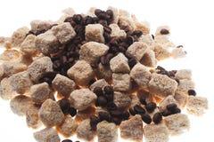 Coffee beans with sugar, macro Stock Photos