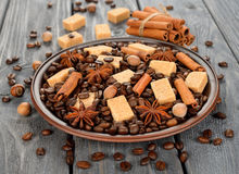 Coffee beans, sugar and spices Stock Images