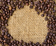 Coffee beans surrounding on sack Royalty Free Stock Image