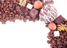 Coffee beans and sweetnesses Royalty Free Stock Photo