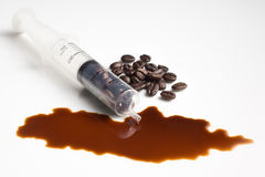 Coffee beans in syringe Royalty Free Stock Image