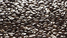 Coffee beans on the table background blurred abstract blurred. Coffee beans on the table background blurred abstract background blurred abstract background royalty free stock photos