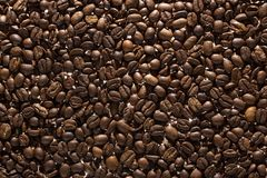 Coffee beans on the table background blurred abstract blurred. Coffee beans on the table background blurred abstract background blurred abstract background royalty free stock photo