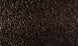 Coffee beans on the table background blurred abstract blurred. Coffee beans on the table background blurred abstract background blurred abstract background royalty free stock image