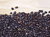 Coffee beans on table closeup Royalty Free Stock Images