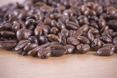 Coffee beans on the table Royalty Free Stock Photos
