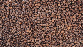 Coffee beans are on the table. Rotate. Slow motion stock video footage