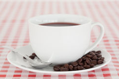 Coffee and beans on a tablecloth. Against a white background Royalty Free Stock Photography
