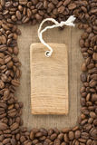 Coffee beans and tag price label on wood Royalty Free Stock Photo