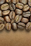 Coffee beans and text space. On brown background Stock Photography