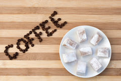 Coffee beans text with turkish delight Royalty Free Stock Photography