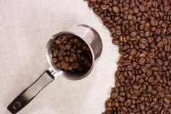 Coffee beans at textile Stock Photos