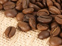 Coffee beans on textile Royalty Free Stock Photo