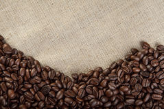 Coffee beans on textile background photo Stock Photography